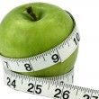 Apple with tape measure — Stok fotoğraf