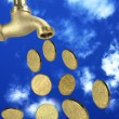 Tap coins falling sky - Stock Photo