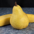 Pear and banana on table top — Stock Photo