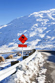 Road sign ice and grit — Stock Photo