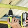 Putting up ceiling battens — Foto Stock