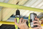 Putting up ceiling battens — Stock Photo