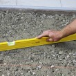 Stock Photo: Leveling ground for paving