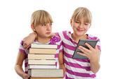 Books vs ebook reader — Stock Photo