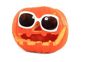 Halloween pumpkin with sunglases — Stock Photo