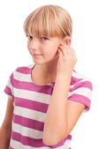 Young Girl setting her hearing aid — Stock Photo