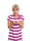 Girl holding lots of hearing aids in her hands. — Stock Photo