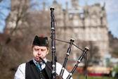 Scottish Bagpiper playing music — Stock Photo