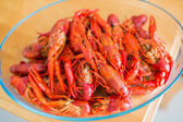 Red boiled crawfish in clear glass bowl — Stock Photo