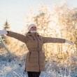 Young girl enjoys snow falls — Stock Photo #40992165
