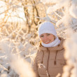 Young girl smiling on sunny winter weather — Stock Photo #40993393