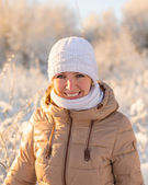 Young girl smiling in winter — Stock Photo
