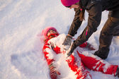 Girl sprinkled with snow — Stock Photo