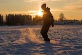 Girl in winter in the sun — Stock Photo