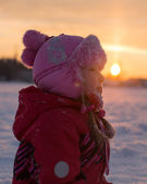 Portrait of little girl in winter at sunset — Stock Photo