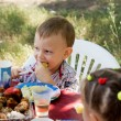 Stock Photo: Little boy enjoying party food