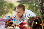 Little boy enjoying party food — Stock Photo