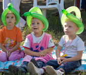 Three little children at a birthday party — Stock Photo