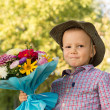 Happy youngster with bouquet of flowers — Stock Photo