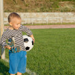 Little boy waiting to play soccer — Stock Photo