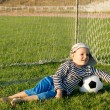 Stock Photo: Barefoot youngster with soccer ball