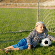 Barefoot youngster with soccer ball — Stock Photo
