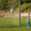 Mother and son throwing a ball — Stockfoto