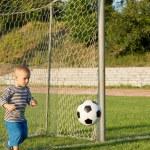 Small boy playing goalkeeper — Stock Photo