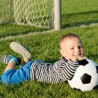 Small boy kicking a soccer ball — Stock Photo #12899515