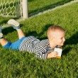 Small boy kicking a soccer ball — Stock Photo #12899518