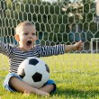 Small boy kicking a soccer ball — Stock Photo #12899555