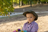 Cute little boy with serious expression — Stock Photo