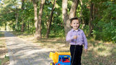 Little boy pulling a toy truck — Stock Photo