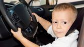 Little boy driving car — Stock Photo