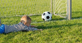 Small boy misses the goal — Stock Photo