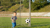 Small boy playing goalkeeper — Stock Photo