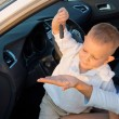 Boy playing with his mothers car key — Stock Photo