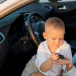 Stock Photo: Little boy giving his mother a car key