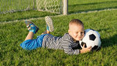 Small boy kicking a soccer ball — Stock Photo