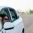 Female driver leaving a gas station — Stock Photo #13068456