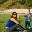Mum and son playing soccer — Stock Photo #13068664