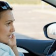 Woman behind the wheel of a car — Stock Photo #13068862