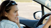 Woman behind the wheel of a car — Stock Photo