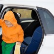 Little boy climbing out of a car — Stock Photo