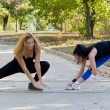 Stock Photo: Two women working out together
