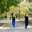 Two women jogging in a park — Stock Photo