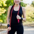 Happy healthy woman with skipping rope — 图库照片