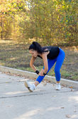 Fit woman limbering up — Stock Photo