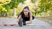 Woman athlete warming up — Stock Photo