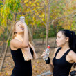 Women athletes drinking water — Stock Photo